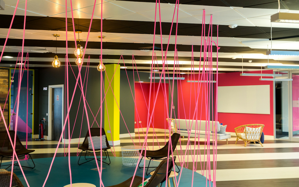 Brightly Coloured Office Space with Striped Floor and Ceiling And Pink Ropes