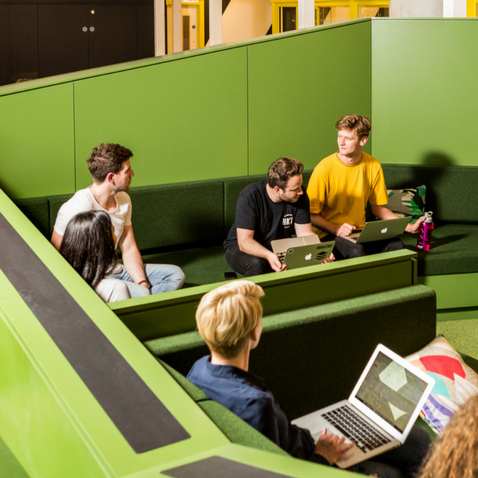 Huckletree's team discussing in Sunken Seating, Huckletree West
