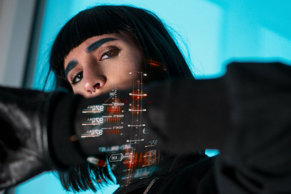 Girl with black short hair and immersive tech detailing against blue background