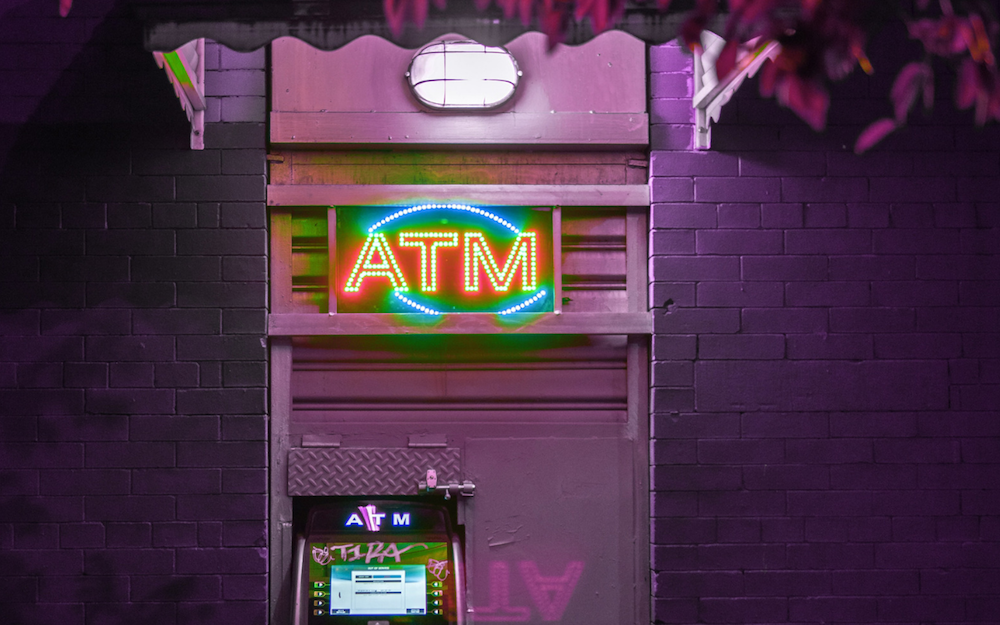 Purple Neon Lit ATM Machine