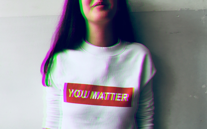 Woman wearing a Supreme style white t-shirt reading You Matter