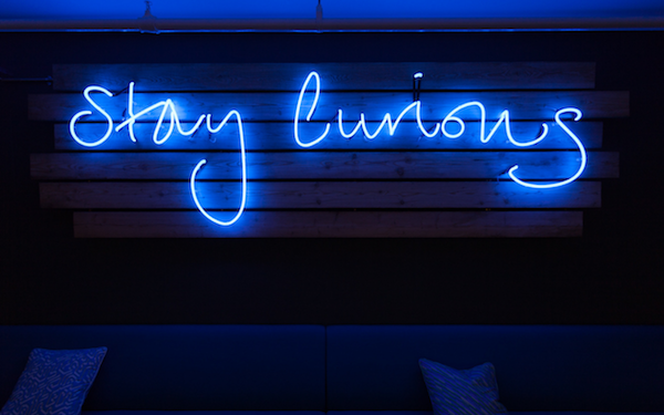 Blue neon sign breakout space