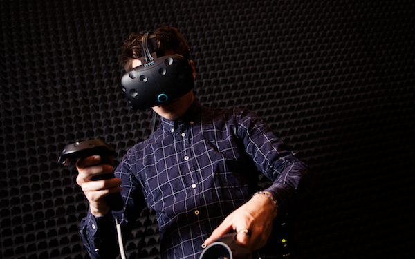 Man wearing HTC Vive Headset in Immersive Breakout Space