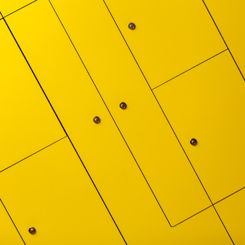 Wall of yellow lockers in Huckletree Shoreditch