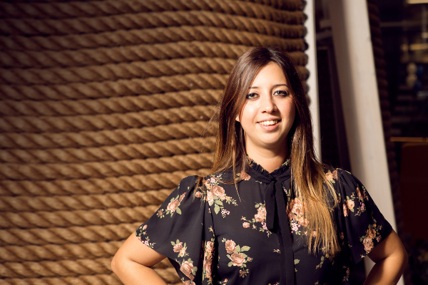 Huckletree Hiring: Brunette woman smiling in a floral top