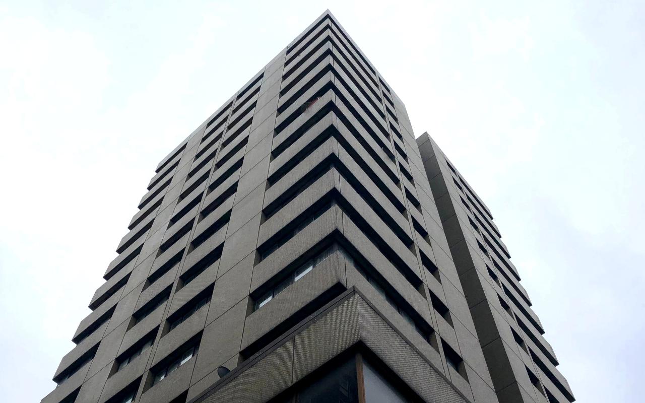 Angled shot of Brutalist building, Soho Workspace