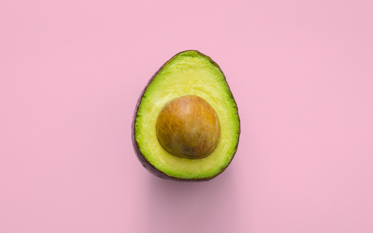 plant based: avocado on a pink background