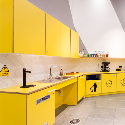 Yellow kitchen at Huckletree West