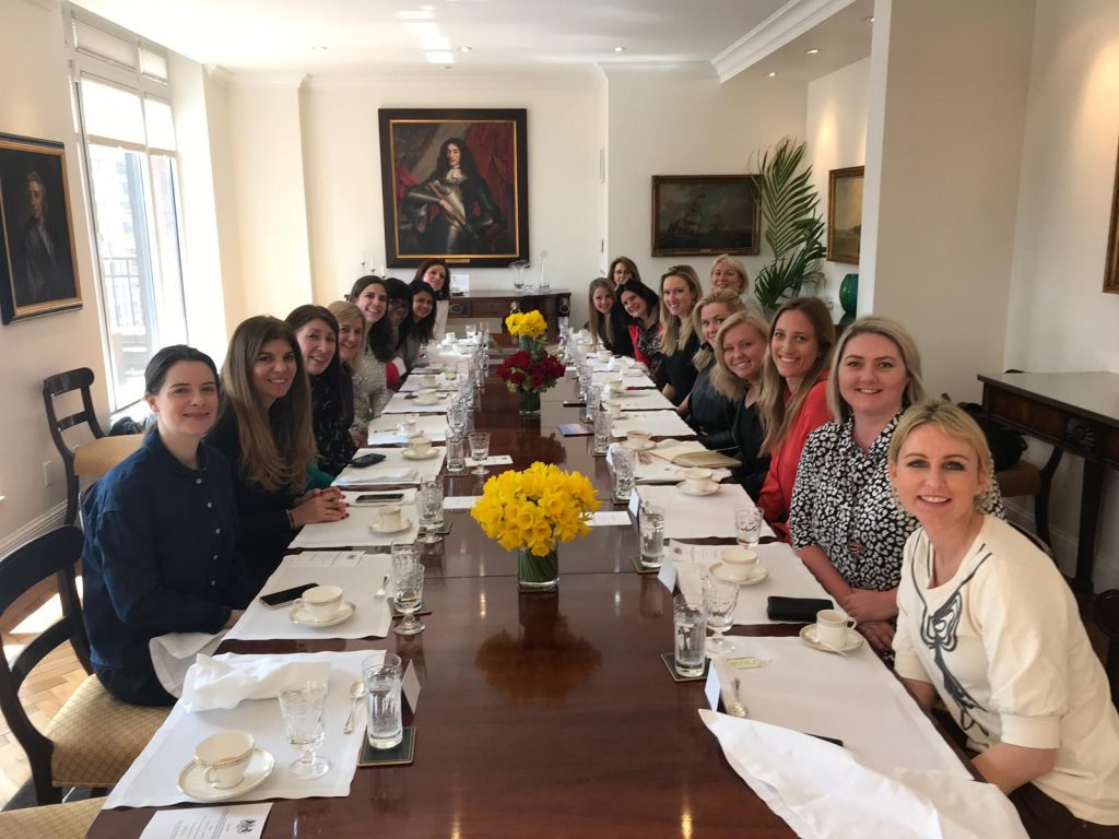 Together Films: Large group of female founders seated at boardroom table, smiling